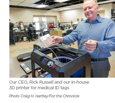 Our CEO, Rick Russell and our in-house 3D printer for medical ID  tags